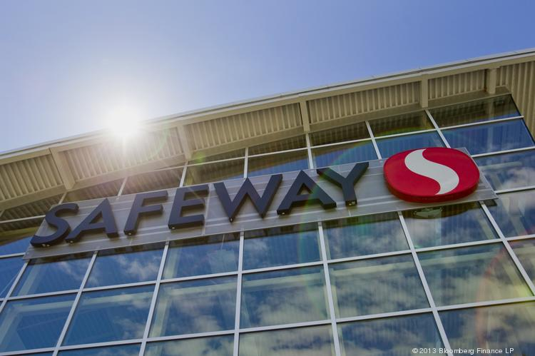 Safeway Inc. signage is displayed at a grocery store in Vancouver, British Columbia, Canada, on Thursday, June 13, 2013. Kroger may be interested in buying Safeway.