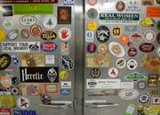 Beer stickers on a fridge at the Indeed brewery.