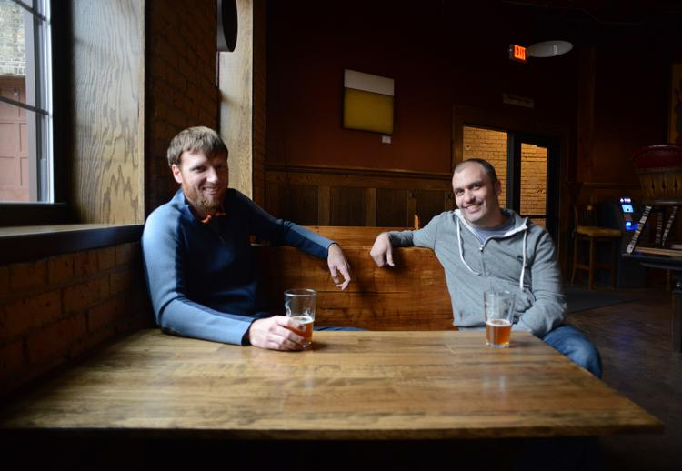 Indeed Brewing Co. co-owners Tom Whisenand (left) and Nathan Berndt (right) discuss their expansion plans at their taproom.