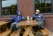 Delivery drivers Brad Ward (left) and Eric Larsen on the Indeed patio after a day at work.
