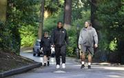 Jaguars players, Uche Nwaneri and Sen'Derrick Marks, walk to practice. Jacksonville Jaguars held their practice at Pennyhill Park Hotel, Bagshot. Twenty miles southwest of London.