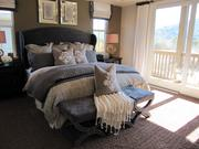 A master bedroom in one of the model homes with a balcony that overlooks the Berkeley Hills.
