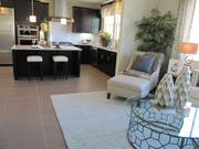A kitchen and adjacent living room in Orinda Grove.