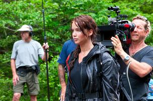 Jennifer Lawrence on the set of The Hunger Games. Lionsgate has made a hire that may bring a video game of the popular movie to life.