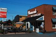 """The Diamond Restaurant, a block away from The Penguin, opened later in 2011 and is now a competitor. Both eateries serve fried pickles. The Diamond's version claims to be """"the neighborhood's first and best original recipe."""""""