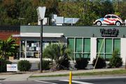 Pinky's Westside Grill, at the intersection of Freedom Drive and West Morehead Street, also has a connection to The Penguin -- beyond having fried pickles as a menu staple. Its founder, Greg Auten, was among the group that revived The Penguin a decade ago.