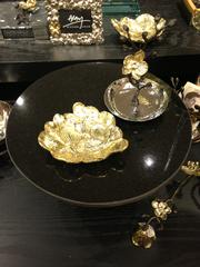 Small dishes and table toppers, like these two pieces, make useful gifts, Aram said. These two pieces are from the Gold Orchid line, a collection exclusively sold at Neiman Marcus.
