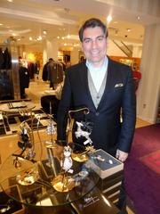 Aram poses with Christmas ornaments from his Fall 2013 collection.