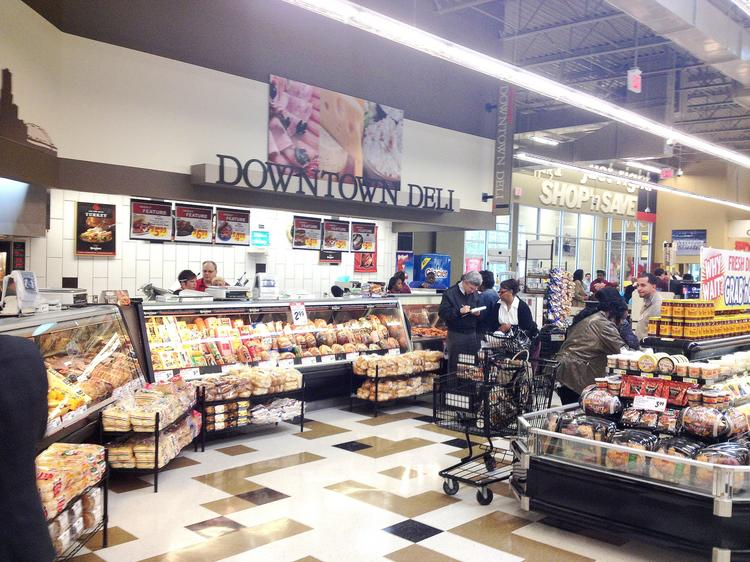 Shoppers stroll through the Shop 'n Save during its Oct. 17 grand opening.