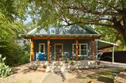 This 1935 habitat is vintage Texas bungalow. The property in the Bouldin-South Congress neighborhood was created by Merzbau Design Collective. Renovations includes a rebuilt gable roof with a steep pitch and an extended front porch using reclaimed travertine from the LBJ Presidential Library that was remodeled. The house includes a private guest suite for a frequent family visitor — grandma.