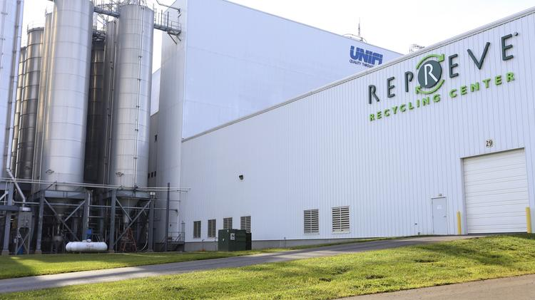 Unifi announced Tuesday that it is expanding its Repreve Recycling Center in Yadkinville with 10 jobs to increase production of its environmentally friendly yarn.