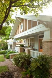 Designed by architect Nick Deaver, this restored craftsman bungalow in Clarksville was nearly tripled in size to create a work studio and rental apartment. The 3,100-square-foot house features an indoor bathing porch, a bright white guestroom in the attic and an elevated covered porch with unique design touches.