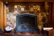A closer look at the mosaic fireplace designed by Kirtland Cutter.