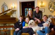 From left to right, bottom row: Oliver Boal, 16; Sarah Boal, 13; Stanly, the goldendoodle; Sebastian Boal, 18; and Ricky, the maltese-poodle mix. Top row: Kelly and Peter Boal, in the family living room.