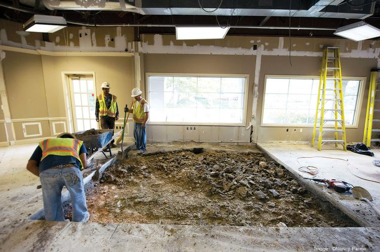 Workers are renovating a SouthPark office to become the new home of Paragon Bank's Charlotte branch, which is experiencing a rapid rise in deposits.