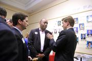 Malcomb D. Coley (center) talks with Edwin Peacock at the candidates' reception.