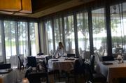 A private dining room is surrounded by the view of the lake.