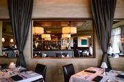 A picturesque view of the main dining room from the private dining area