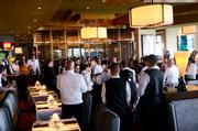 Servers hold a shift meeting before dinner service.