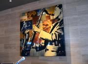 Artwork in the bar area in the style of the jazz music played during service.