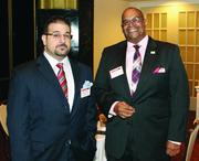 North Side Christian Health Center's Michael Mingrone, left, and Floyd Cephas