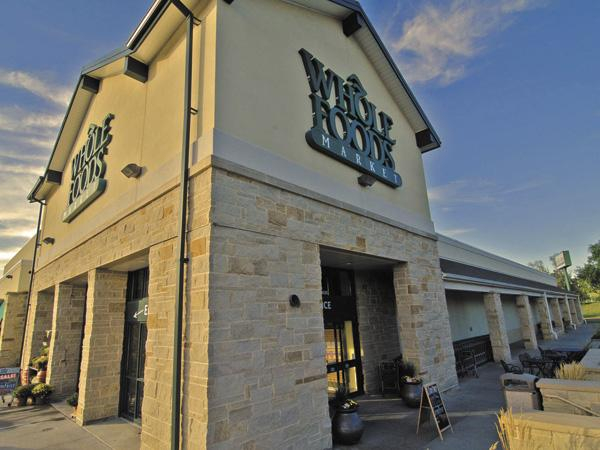 Whole Foods will open its first local store next fall and compete with Dorothy Lane Market and other grocers.