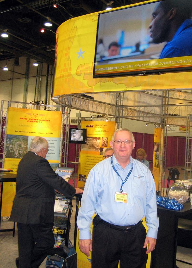 David Bossemeyer, vice president of business development with the Greater Wichita Economic Development Coalition, takes a break from a busy schedule of meetings Wednesday at the National Business Aviation Association convention in Las Vegas.