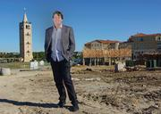 Developer Jeffory Blackard stands in front of ongoing construction at Adriatica, a  sprawling, mixed-use project in McKinney that was modeled on a Croatian fishing village. Another village-style community is slated for development in Westlake.