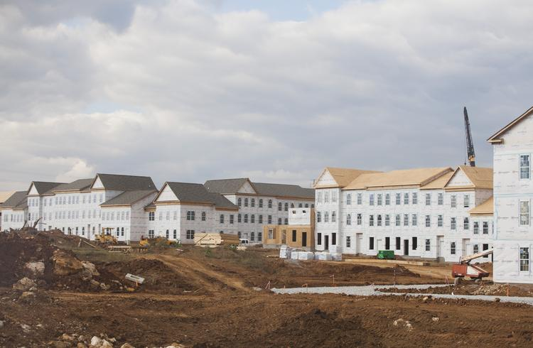 The LC Idlewild apartments under construction on English Station Way will be one- and two-bedroom units that will rent from $900 to $1,300 per month. They will be townhouse-style apartments intended to have the feel of a brownstone walk-up.