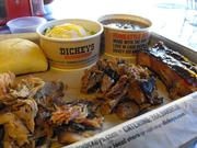 Dickey's three-meat combo -- in this case, pulled pork, chopped brisket and pork ribs -- cost $12.95 and comes two sides and a roll.