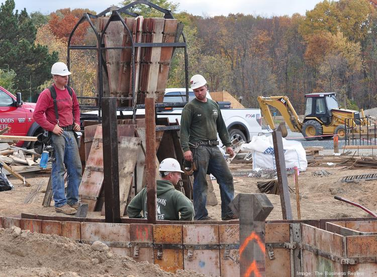 Subcontractors work on the new $70 million Village at New Loudon project located on Route 9 in Loudonville, NY.