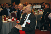 Rob Teach of U.S. Bank looks on as Jay Timmons delivers a keynote speech.