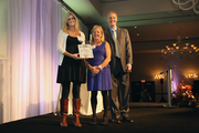 Dara Abell, left, with Jeanna Grossen, accepts the award for product innovation for GK Machine Inc.