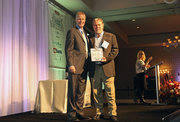 Rob Scofield accepts an award for Chinook Asia, a finalist in the medium companies category.