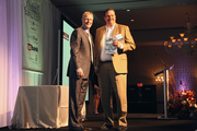 Greenberry Industrial CFO Jim Grabsky, right, accepts an award an award in the large companies category from Business Journal Editor Rob Smith.