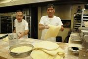 Bakery chefs Lito Madallon, left, and Mario Flores making dough for butter rolls at Liliha Bakery.