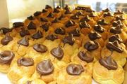 """Close up shot of chocolate coco puffs on display at Liliha Bakery. The pastries have been featured on two episodes of the television show """"Hawaii Five-0."""""""