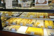 A selection of fresh pastries and breads on display at Liliha Bakery.