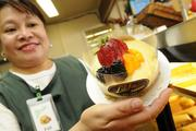 Cheesecake with fresh fruit is a popular dessert at Liliha Bakery.