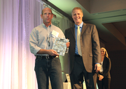 Bill Combs accepts an award for Bogs Footwear as a finalist in the medium companies category.