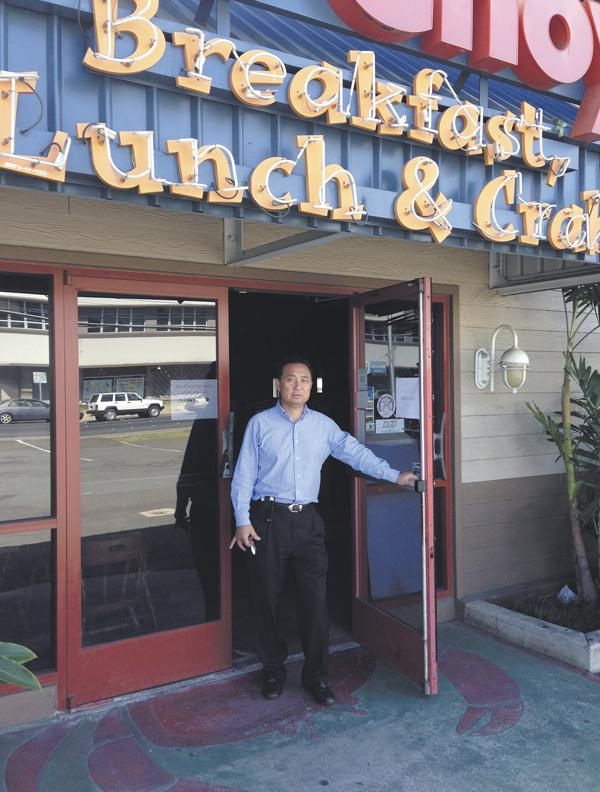 Peter Kim stands in the doorway of the former Sam Choy's Breakfast, Lunch & Crab, the future site of his second Liliha Bakery.
