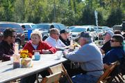 Thousands of people come from around the region for take-out barbecue or to eat and socialize.