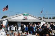 This year marked the 84th anniversary of the barbecue. The pig atop the sandwich stand is repainted each year.