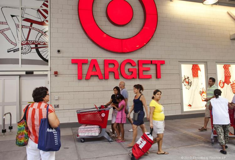 Shoppers pass the Target Corp. logo outside the new store in the East Harlem neighborhood of New York on Sunday, July 25, 2010. The store says hackers have stolen the debit and credit card numbers of up to 40 million customers.