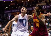 The Charlotte Bobcats defeated the Cleveland Cavaliers in a preseason game this week. Here, Bobcats rookie Cody Zeller jockeys for rebound.