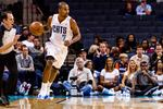 Charlotte Bobcats reach for a rebound