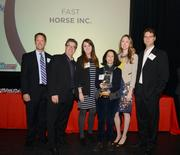 Fast Horse employees accepting their award.
