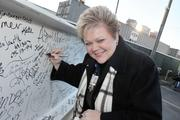 Debbie Hayes, chief nursing officer and chief hospital officer, signs the final beam.