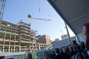 The final beam is lifted to the top of Christ Hospital's new structure, 447 feet higher than the top of downtown Cincinnati's Carew Tower.