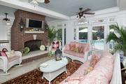 Taylor: A screened porch overlooks the backyard.
